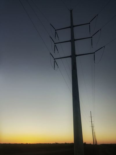 High voltage and a sunrise. Power Lines High Voltage Line Sunrise West Texas Texas Pecos River Sonoran Desert Sonoran Desert Sunset Desert The Great Outdoors With Adobe Horizon Over Land Sunrise Sunset Fire In The Sky Glowing Sky Orange Glow Beauty In Nature Saturation