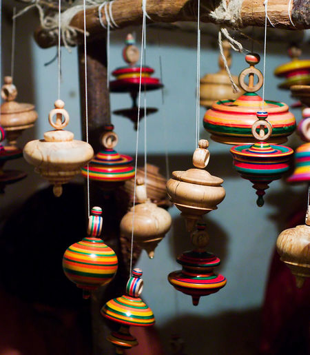 Close-up of multi colored toys hanging in store for sale