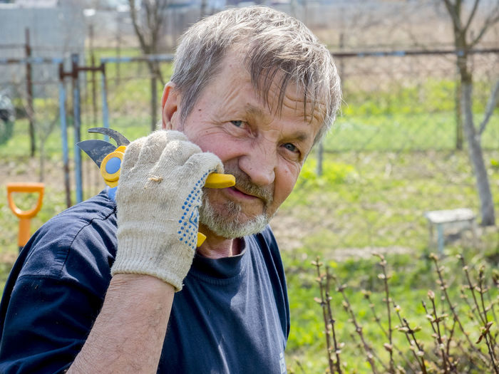 Portrait of man holding pruning shears