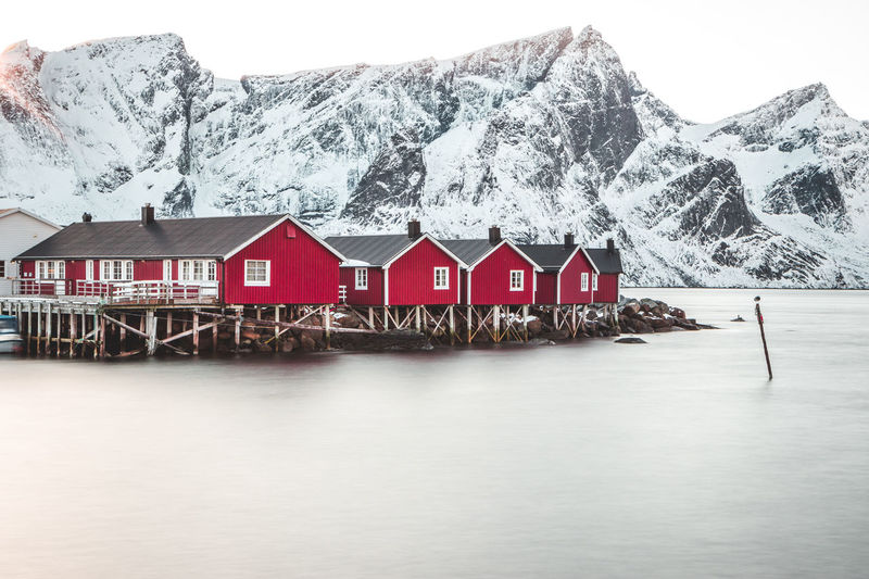 Hamnoy, beautiful place in Lofoten Islands Mountain Architecture Built Structure Water Building Exterior Cold Temperature House Beauty In Nature Scenics - Nature Snow Winter Waterfront Day Nature Tranquil Scene No People Tranquility Snowcapped Mountain Mountain Range Outdoors Cottage Rorbu Lofoten Norway Iceland 2018 In One Photograph