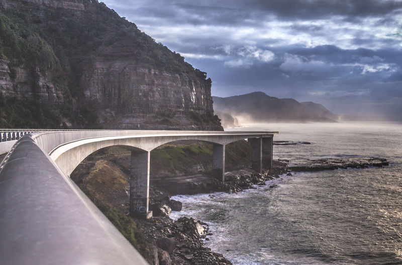 Seacliff Bridge, Wollongong, New South Wales, Australia Bridge - Man Made Structure Travel Destinations Cloud - Sky Architecture Nature Outdoors Fog No People Water Beauty In Nature Scenics Connection Landscape Sky Day Bridge Sea And Sky Mountain Seascape Cloudy Curving Lines Ocean Moody Overcast Australia EyeEmNewHere Shades Of Winter