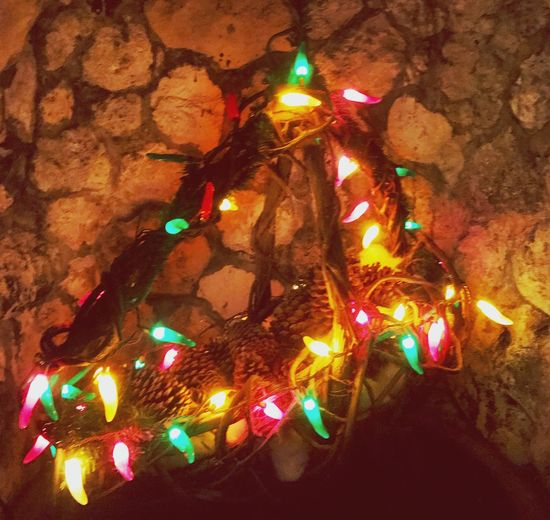 Illuminated Night Multi Colored No People Christmas Decoration Christmas Lights Lights In The Dark Lighting Up The Night... Seasonal Decorations Light Display Colored Lights Holiday Lights Lighting Decoration Holiday - Event Garden Display Stone Wall Background