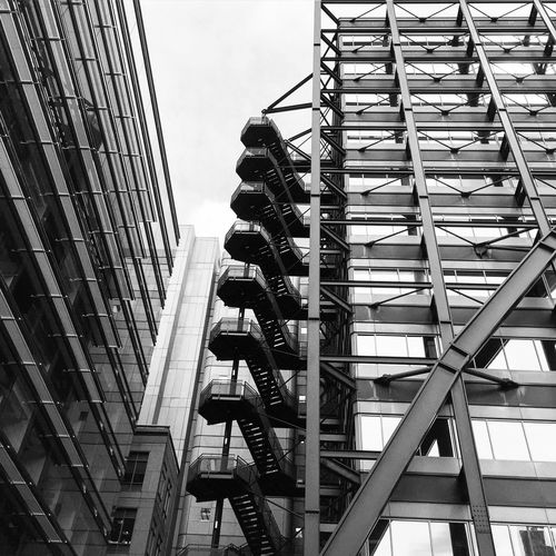 Low Angle View Of Modern Building With Fire Escape Against Sky