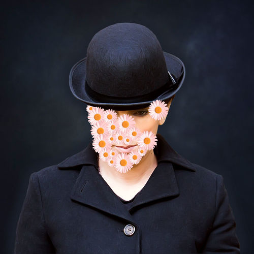 Digital Composite Image Of Woman With Flowers On Face Against Black Background