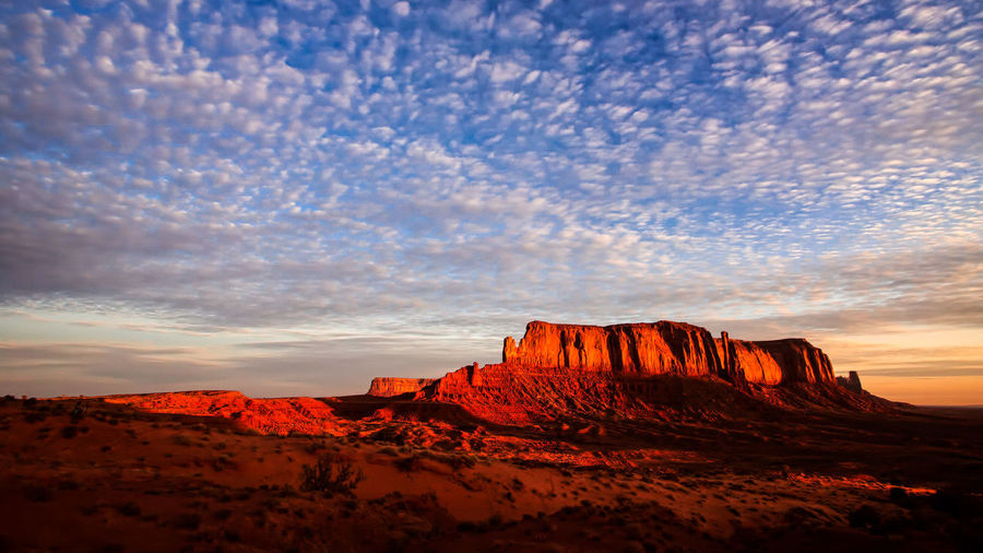 Rock formations against sky during sunset