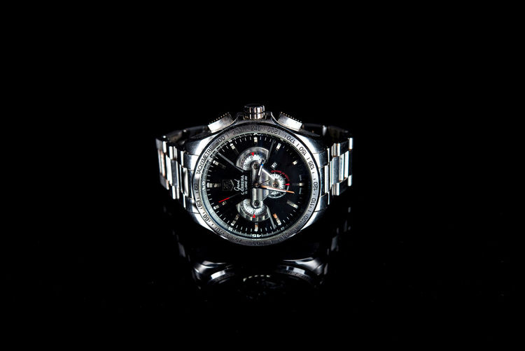 Old Tag Heuer still elegant Studio Shot Black Background Time Clock Watch Indoors  Copy Space Close-up Wristwatch Metal Luxury Accuracy Silver Colored Wealth Still Life Single Object Jewelry No People Instrument Of Time Personal Accessory Tagheuer