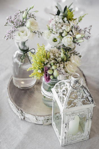 romantic wedding table decoration design with flowers and rustic details Flower Arrangement No People Rustic Style Bouquet Flowers Interior Design Wedding Table Table Decoration Table Decor Close Up Detail Romantic Soft Colors  Natural Style Retro Style Vintage Style