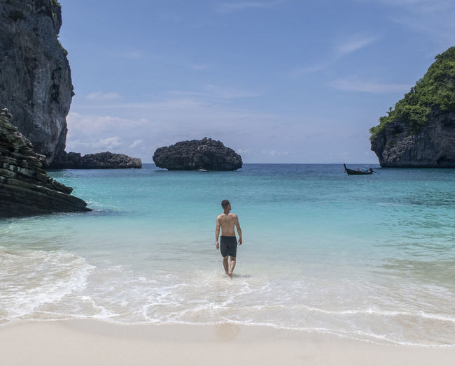 Sea Water Beauty In Nature Land One Person Scenics - Nature Leisure Activity Beach Lifestyles Sky Real People Nature Day Rear View Rock Rock Formation Idyllic Shirtless Young Adult Horizon Over Water Outdoors Holiday Thailand