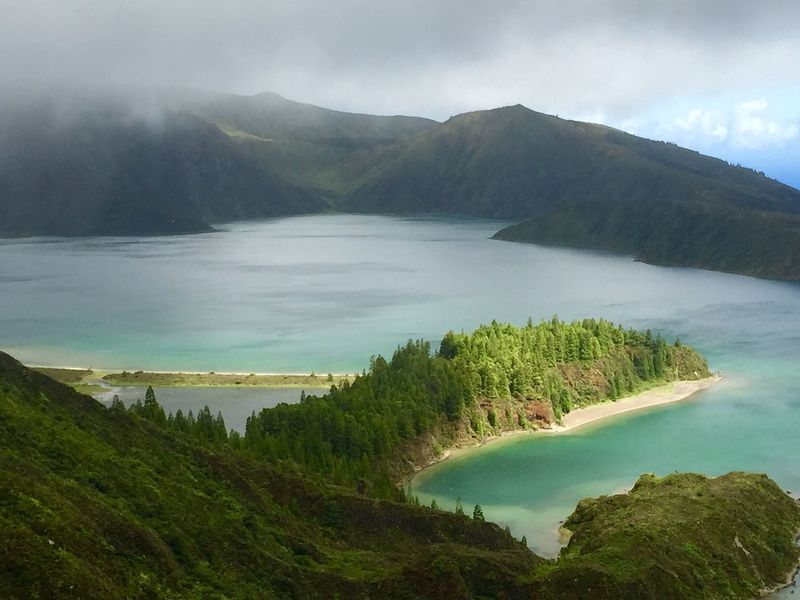 Logoa do Fogo Mountain Beauty In Nature Scenics Nature Water Tranquil Scene Tranquility Mountain Range No People Sky Landscape Outdoors Day Sea Physical Geography Travel Destinations Tree Lake Travel Lagoa Do Fogo Azores