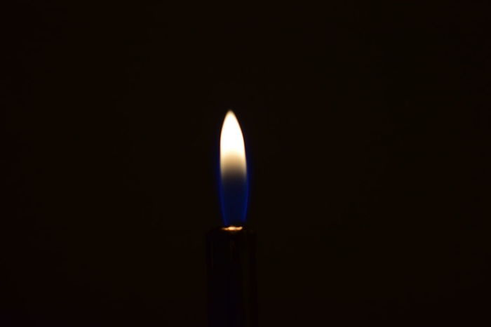 EyeEmNewHere Black Background Burning Candle Close-up Copy Space Cut Out Dark Darkroom Domestic Room Fire Fire - Natural Phenomenon Flame Glowing Heat - Temperature Illuminated Indoors  Lighting Equipment Luminosity Nature No People Studio Shot