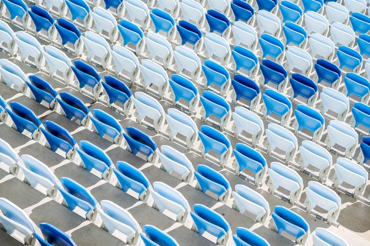 Empty seats in a football stadium in sunlight