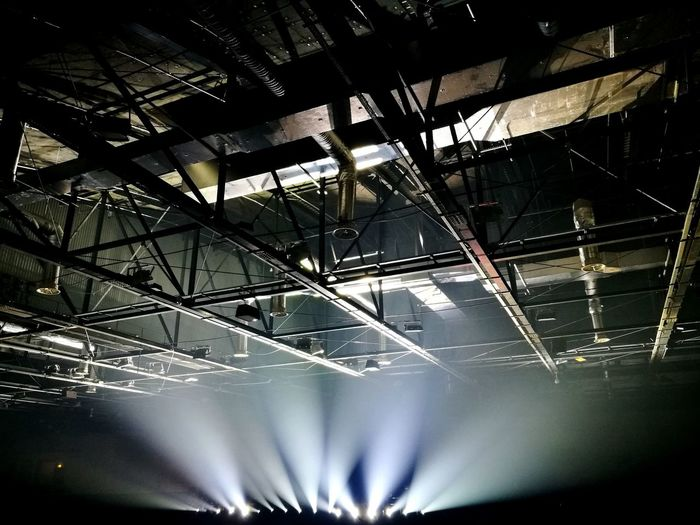 Arena ceiling lighted by reflectors Industrial Ducts Structure Shadows & Lights Music Concert Entertainment Concert