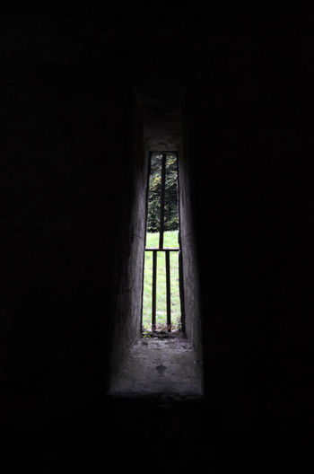 Looking Out Of The Window Architecture Built Structure Dark Indoors  Narrow Opening Spooky Window