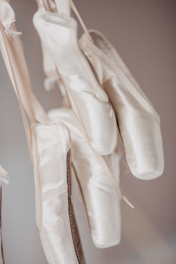 Close-up of clothes hanging against white background