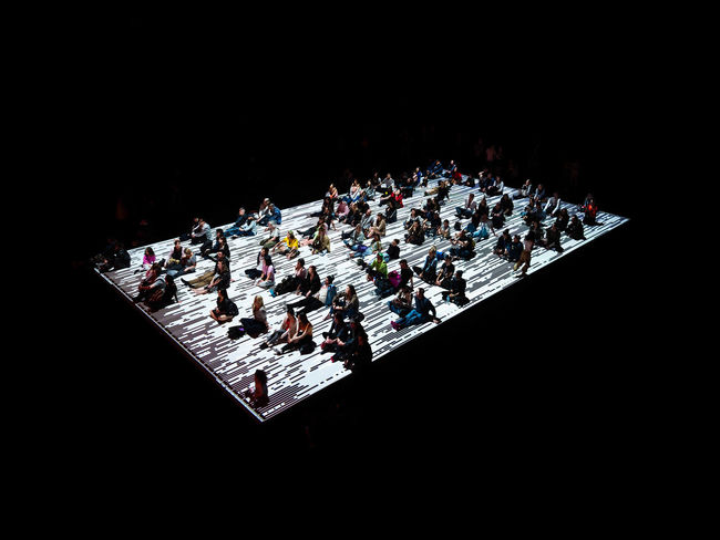 """A large group of people sit on a projected floor watching a futuristic visual and audio display by Ryoji Ikeda. The installation is named Micro   Macro. """"My work is created by reducing sound, light and the world into sine waves, pixels and data… so that the world can be viewed once more at a different resolution."""" Ryoji Ikeda Visual Creativity Art Indoors  Large Group Of Objects Night Sky Studio Shot Week On Eyeem The Photojournalist - 2018 EyeEm Awards The Architect - 2018 EyeEm Awards The Creative - 2018 EyeEm Awards The Street Photographer - 2018 EyeEm Awards HUAWEI Photo Award: After Dark"""