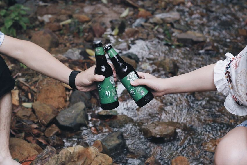 Beer Cheers Summer River Water Flow Real People Lifestyles Drink Human Hand Bottle Outdoors Refreshment Two People Friendship Day Women Leisure Activity Human Body Part Motion Alcohol Togetherness Adventure The Week On EyeEm EyeEmNewHere Young Adult Summer Exploratorium
