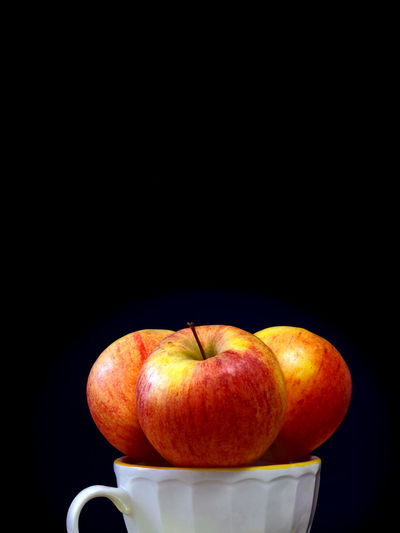 Close-up of apple on black background