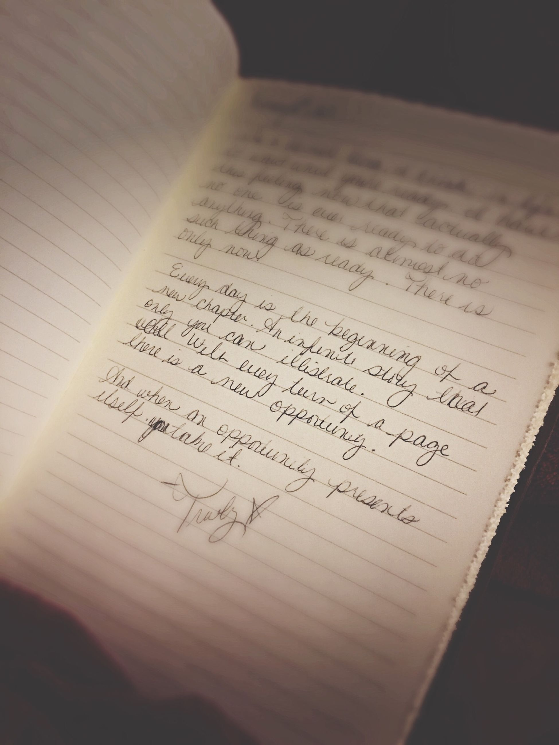 indoors, text, paper, western script, communication, book, table, education, still life, close-up, high angle view, no people, wood - material, handwriting, page, selective focus, pen, document, open, message