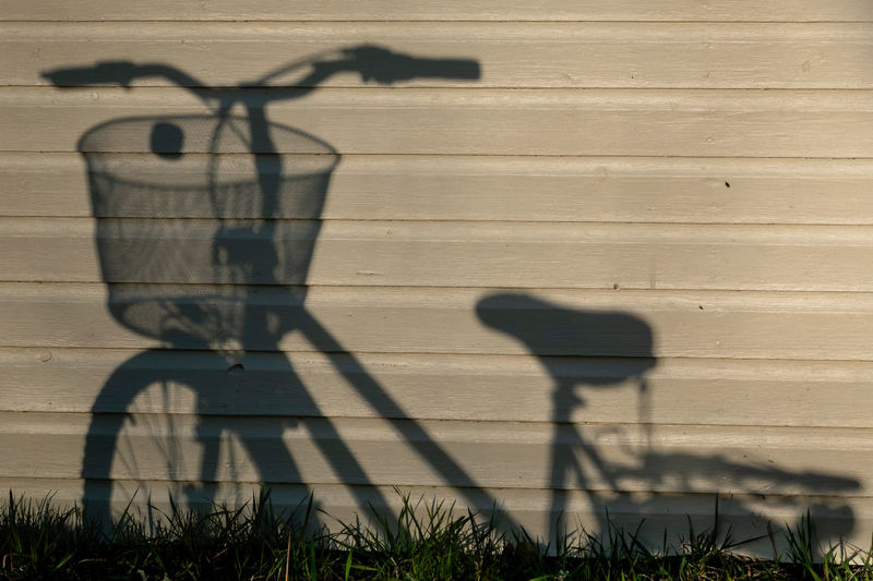Shadow of bicycle on wall