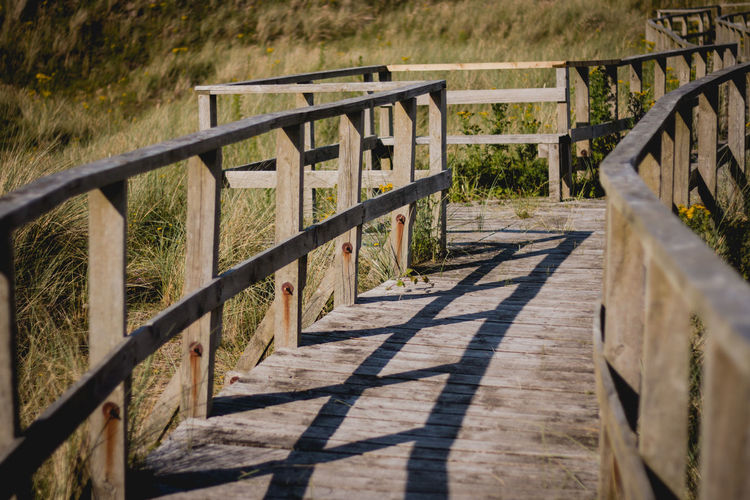 Architecture Built Structure Day Grass Nature No People Outdoors Railing Shadow Sunlight The Way Forward Wood - Material