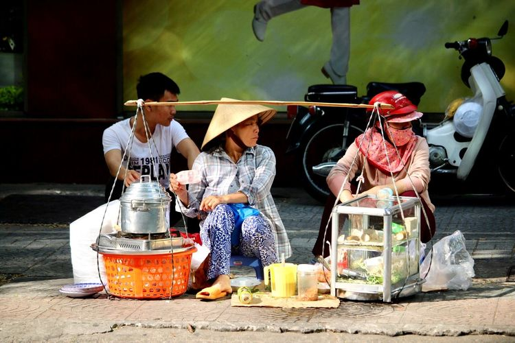 Real People Container Day Women Men Clothing The Traveler - 2018 EyeEm Awards Traditional Clothing Sitting Occupation Small Business Outdoors Hat Nature Food And Drink People Adult Sunlight Lifestyles Selling