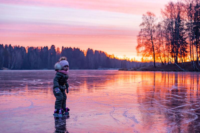 Full length of man standing in lake during winter