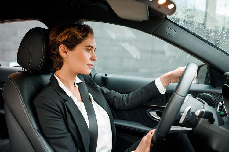 Businesswoman driving car