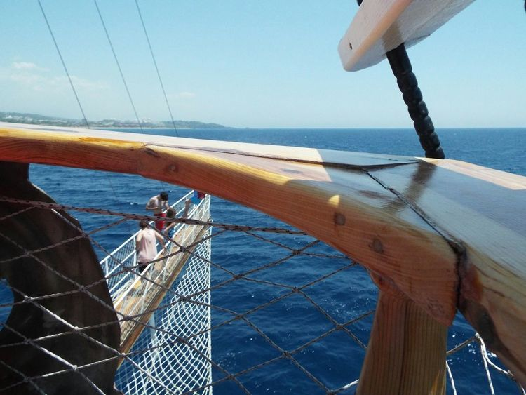 Wooden Railing Wood - Material Rope Railing Rope Focus On Foreground Blue Sky Blue Water Blue Wave Coastline Safety Boat Travel Photography Travel Destinations Tourism Day Trip Tourist Attraction  Sea Mediterranean Sea Boat Trip On A Boat People Bowsprit On The Way