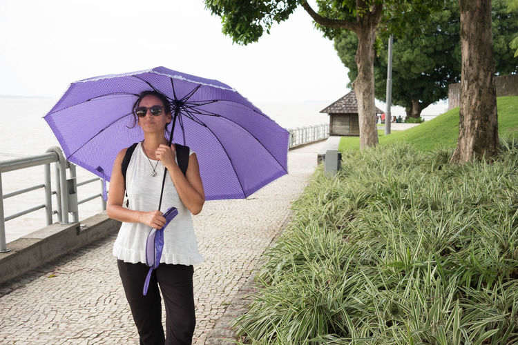 Full length of a woman with umbrella