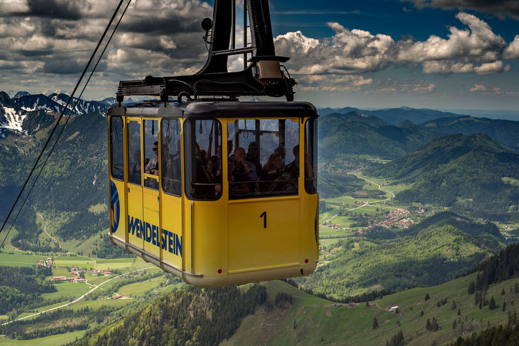 Overhead cable car against mountains