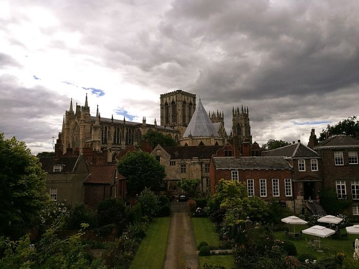 York Minster And Buildings Against Cloudy Sky