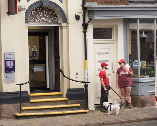 Red Hats and Dog wearing A Lady Wearing A Dog Dogs And Hats Architecture Building Exterior Built Structure Day Full Length Mammal Men Outdoors People Real People Standing
