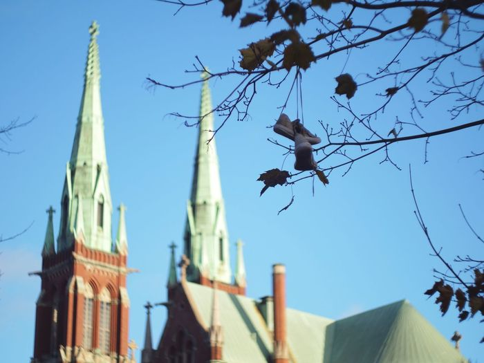 Architecture Shoes Hanging Church Tree Building Blue Sky Finland Clear Sky No People Punavuori Low Angle View Built Structure Focus On Foreground Outdoors Gh5