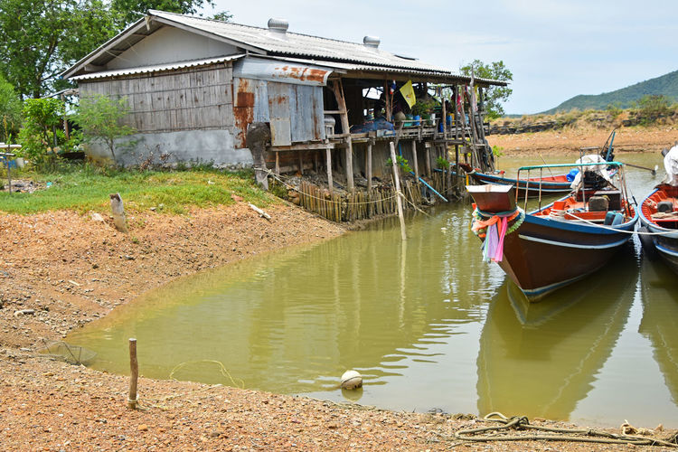 Sea longtail fisherman's boats and house next to bay Ang Thong National Marine Park Angthong Bay Boat Boats Ethnic Fisherman Boat Fishermanvillage Fishermen Boat Fishermenvillage House Hut Local Longtailboat Poor  Poverty Spotted In Thailand Thai Thailand Traditional Village