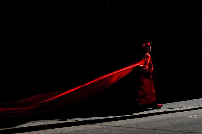 Red umbrella against black background