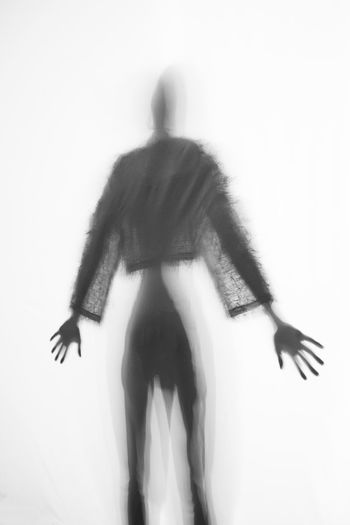One Person Blurred Motion Motion Lifestyles White Background Three Quarter Length Dancing Full Length Indoors  Rear View Standing Adult Real People Wall - Building Feature Women Unrecognizable Person Leisure Activity Hairstyle Obscured Face Silhouette Woman