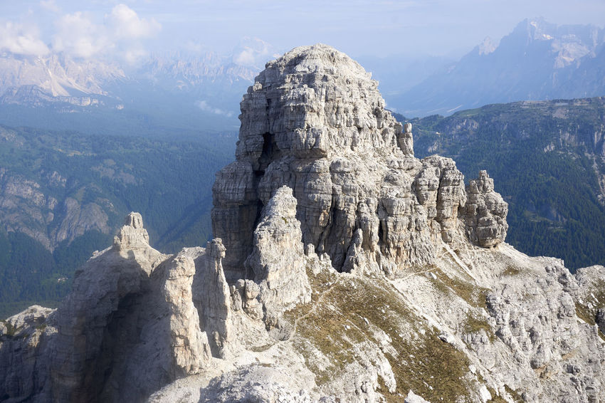 "The curiously shaped summit of Mt. Sfornioi Nord, above Passo Cibiana. Two peculiar pillars of stone stand in the mid of the col right under the summit, named the ""Pupe"". Dolomites, Italy Mountaineering Beauty In Nature Cadore Dolomiti Geology Landscape Mountain Nature Outdoors Rock Formation"