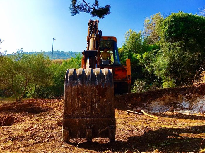 Buldozer EyeEmNewHere Tree Outdoors Spraying Day Sunlight No People Sky Clear Sky Nature