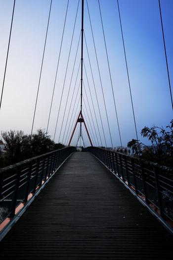 View of suspension bridge against clear sky