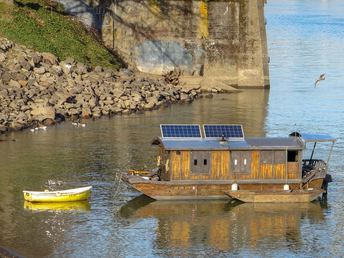 Two Boats Docked Coastline Geese Harbor Horizontal River's Edge Rowboat Travel Water's Edge Willamette River  Blue Boat Brown Houseboat Moored No People Outdoors Reflection Rocks Seagull Tom Mccall Waterfront Park Transportation Vessel Water Waterfront Yellow
