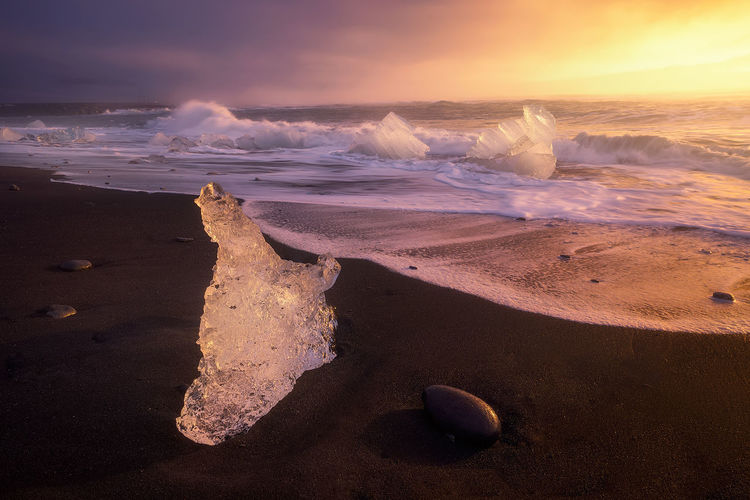 Jokulsarlom´s Beach In iceland Beach Beauty In Nature Horizon Over Water Ice Iceland Nature No People Outdoors Sand Sea Sky Sunset The Great Outdoors - 2017 EyeEm Awards Tranquil Scene Tranquility Water Wave