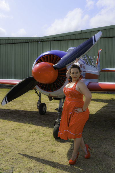 PinUpGirl Pinup Red Dress Air Vehicle Aircraft Airplane Day Elementary Age Front View Full Length High Heels Leisure Activity Lifestyles Looking At Camera One Person Outdoors Portrait Propellor Real People Red Heels Sky Standing Transportation Young Adult Young Women