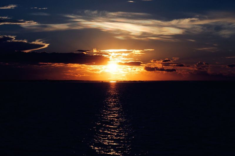 A sunsets beauty Sunset Sky Water Beauty In Nature Scenics - Nature Sea Cloud - Sky
