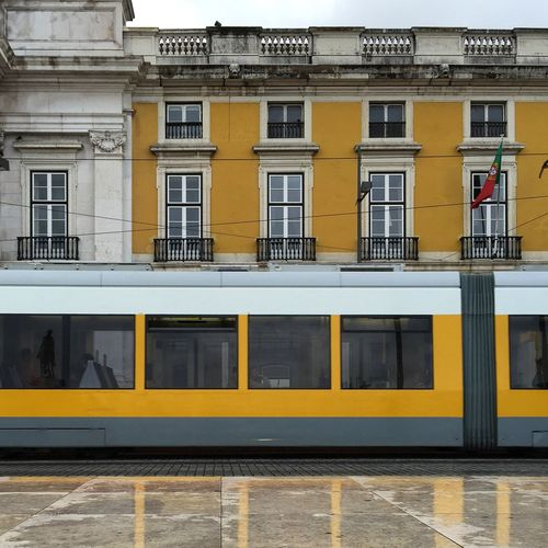 Train At Railroad Station Against Building