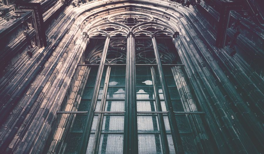 Low angle view of glass window of old building