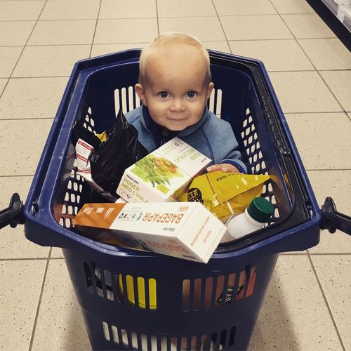 Shopping Transportation Shopping Cart Young Real People Portrait Babyhood Innocence Looking At Camera Toddler  Baby Carriage Cute High Angle View