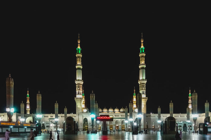 Architecture Masjidil Nabawi Madinah Architecture Building Exterior Built Structure City Clear Sky Green Dome Illuminated Islamic Architecture Mosque Night No People Outdoors Place Of Worship Religion Sky Skyscraper Tall - High Travel Travel Destinations Water