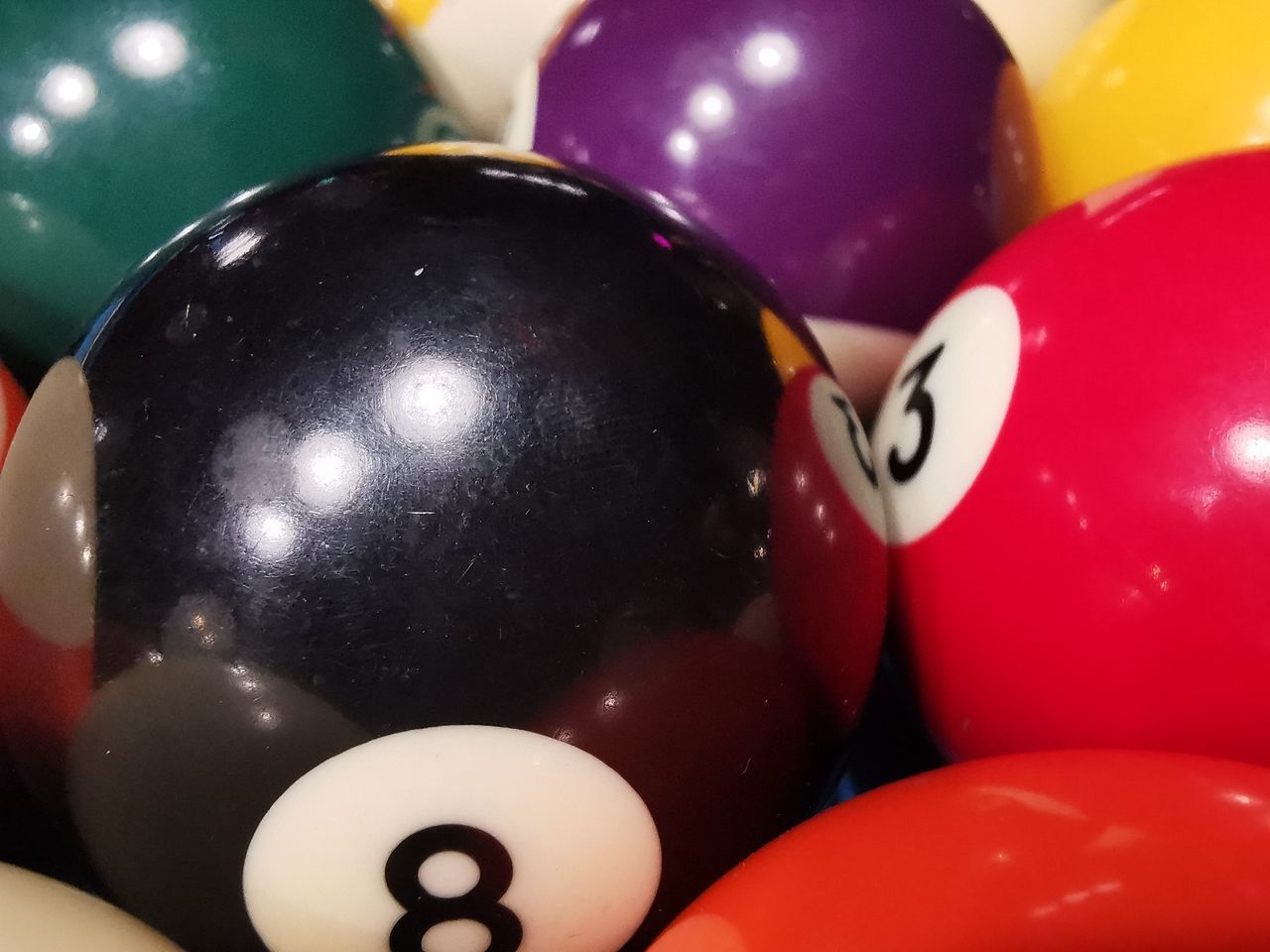 ball, close-up, pool ball, indoors, number, still life, table, sphere, multi colored, sport, pool table, no people, red, pool - cue sport, focus on foreground, balloon, shiny, relaxation, white color, arts culture and entertainment