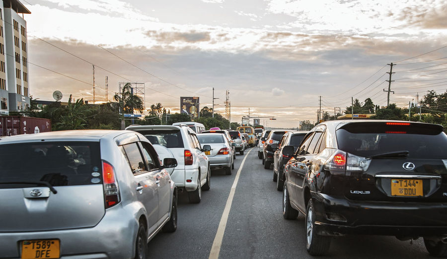 Traffic Traffic Jam Traffic Lights Cars Sunset Transportation Mode Of Transportation Land Vehicle Car Motor Vehicle Sky City Road Cloud - Sky Street Architecture Outdoors Day No People Direction Built Structure Travel