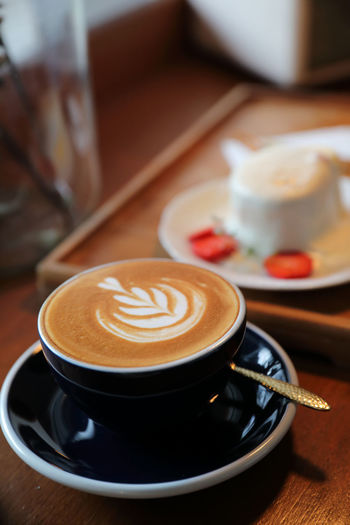 Coffee Food And Drink Coffee - Drink Coffee Cup Drink Cup Mug Refreshment Frothy Drink Hot Drink Crockery Cappuccino Table Kitchen Utensil Still Life Saucer Freshness Froth Art Spoon Food Latte No People Non-alcoholic Beverage Temptation Breakfast